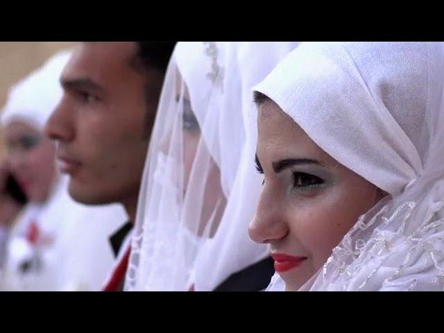 30 couples celebrate simultaneous wedding in Aleppo
