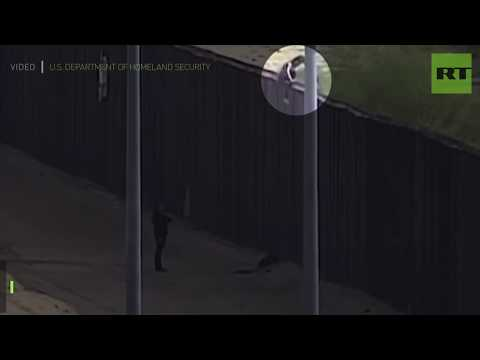 2 teen migrants injured as they fall from US border fence