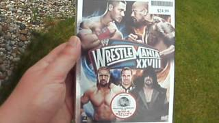 Some of the shit I bought today: 6 pack of Faygo Orange glass bottles and WWE WrestleMania 28 on DVD