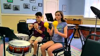 Percussion Camp Playing Maracas and Cabasa