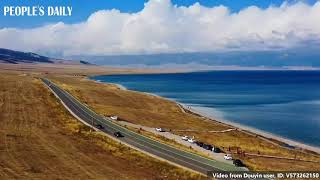 Sew the tranquility into your heart when driving along the edge of Sayram Lake