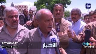 وقفة احتجاجية لسكان مخيم المحطة المهددين بإخلاء منازلهم