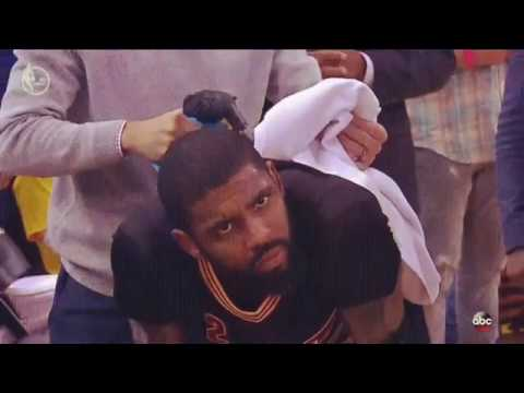 Kyrie Irving uses TheraGun during the 2017 NBA Finals