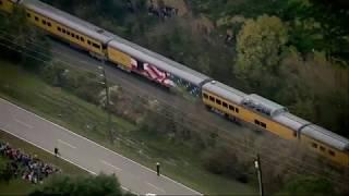 Thousands line Bush casket train route