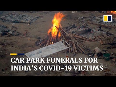New Delhi car park turned into crematorium as India deals with catastrophic Covid-19 crisis