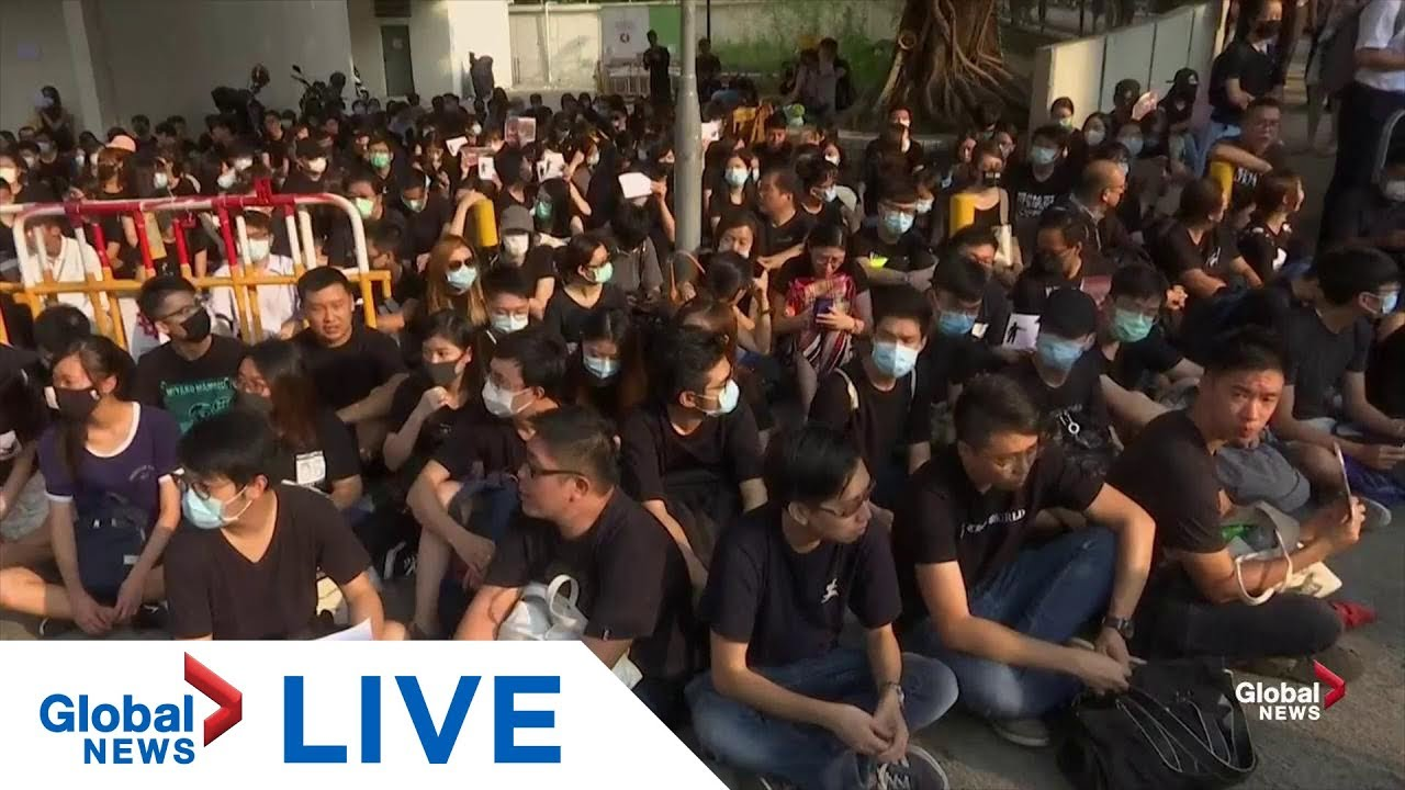 Demonstration held outside school of Hong Kong protester shot | LIVE