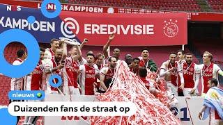 Ajax is kampioen, duizenden fans de straat op