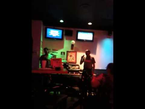 Robbie sings karaoke