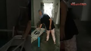 Woman caught tossing furniture from 4th floor Shah Alam flat; video goes viral