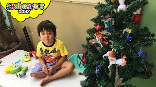 Toddler making his own TOY CHRISTMAS TREE - diy project with christmas toys for kids playtime