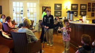 Isabella playing violin for seniors