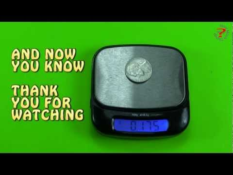 How much does a roll of quarters weigh in grams