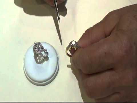 Jewelry Makeover - Re-set Anita's diamond with 2 side marquise diamonds