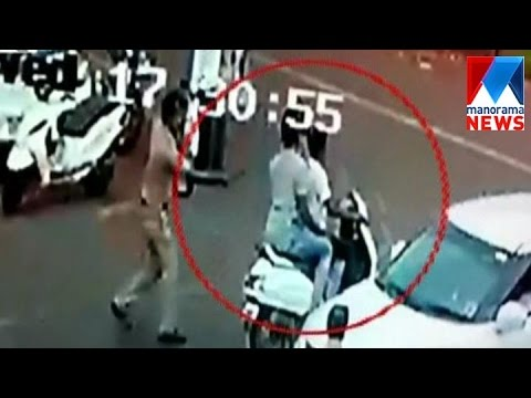 Police betan scooter traveller in Kasargod | Manorama News