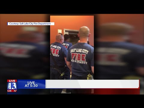 Ken Payne - Firefighters Rescue Police From Elevator In Salt Lake City