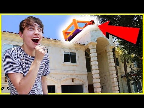 THROWING BOUNCY HOUSE OFF OUR ROOF! (insane)