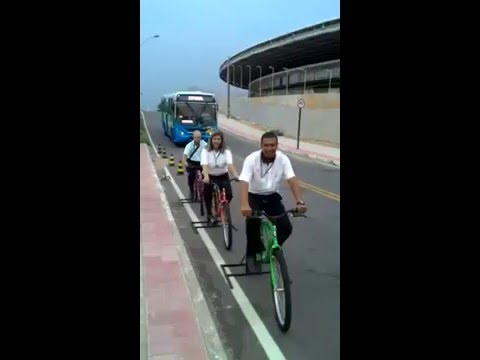 Bus Drivers Forced to Pedal Roadside Stationary Bikes While Buses Whiz Past at High Speed