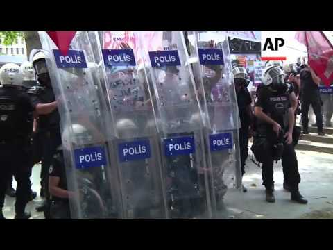 Police fire tear gas, rubber bullets and water cannon as they raid protester camp