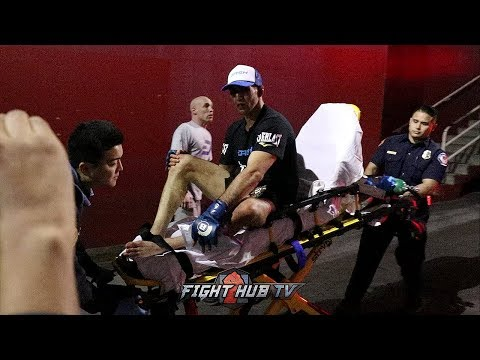 WATCH RORY MACDONALD GET LOADED INTO AMBULANCE AFTER BELLATOR TITLE WIN