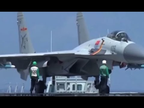 China's J-15 fighters taking off from Liaoning aircraft carrier