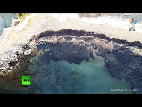 AERIAL: Drone buzzes over oil from tanker leak near Greek shore