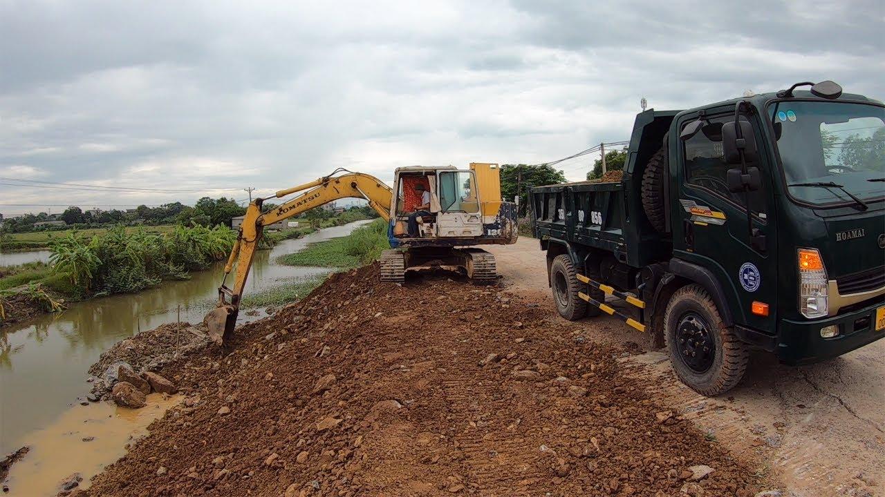 Komatsu Excavator Loading Rock Onto Canal Construction Truck