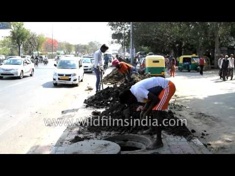 Cleaning the drains of Delhi - sad, pathetic job to have to do...