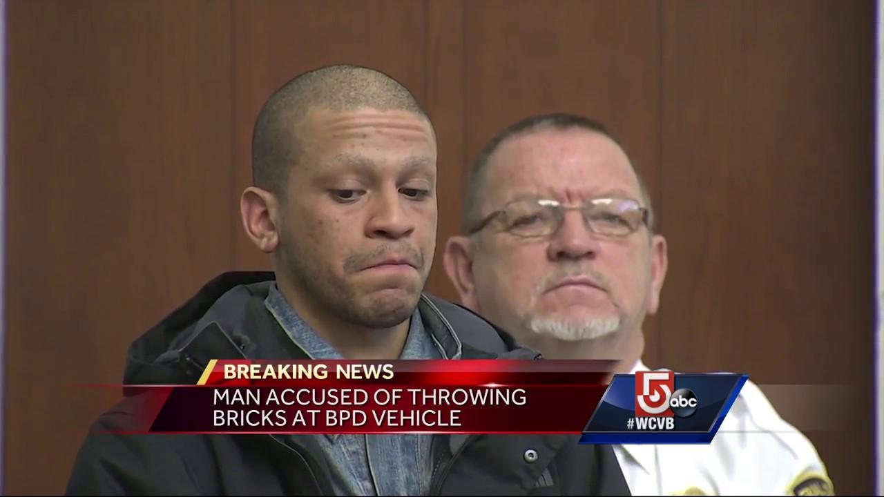 Man accused of throwing bricks at Boston police vehicle