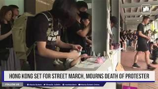Hong Kong set for street march, mourns death of protester thumbnail