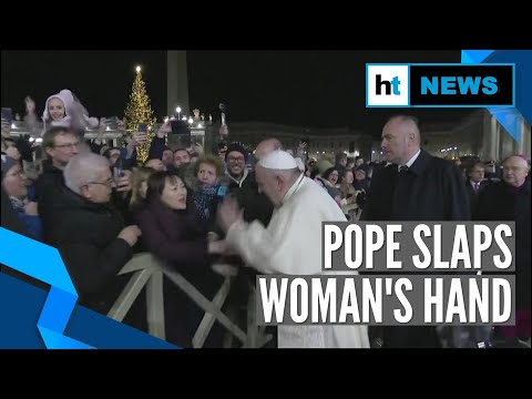 Download Pope Francis slaps woman's hand to free himself after she roughly pulls him