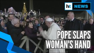Pope Francis slaps woman's hand to free himself after she roughly pulls him