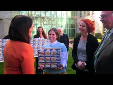 Delivering the 25,000+ Keep Solar Strong petition in Canberra