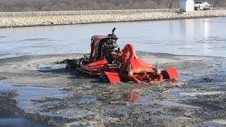Nuhn Lagoon Crawler - Manure Agitation Boat Mixing a Lagoon