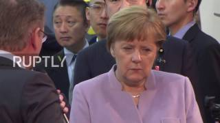 Germany: Merkel and Abe check out new technologies at CeBIT