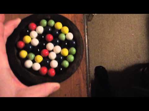 marbles inside circle move counterclockwise when circle is rotated clockwise.