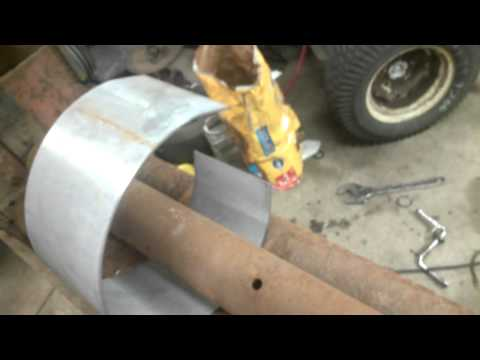 homemade sheet metal roller with an Iron Fireman Coal burning stove auger gearbox