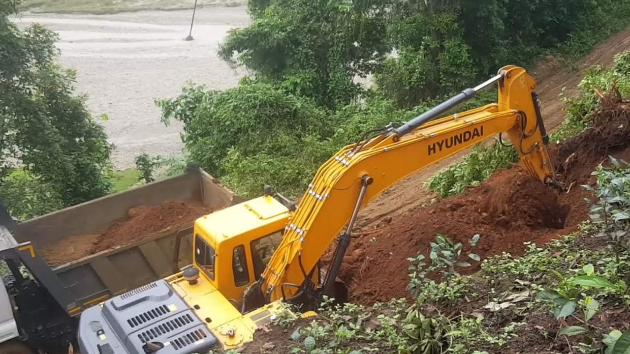 Hilly Road Excavation-Hyundai Excavator-Managing Cut Out Soil