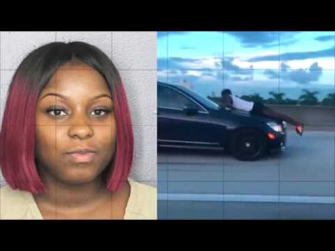 Florida Woman Arrested For Driving With Ex-Boyfriend On Hood Of Her Car.