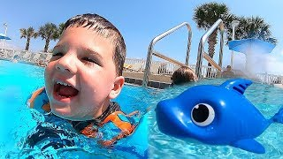 Kids Swimming With Baby Shark Toys in GIANT Swimming Pool! Caleb Pretend Play