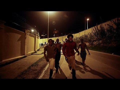 Hundreds of African migrants cross border fence into Spanish enclave of Ceuta