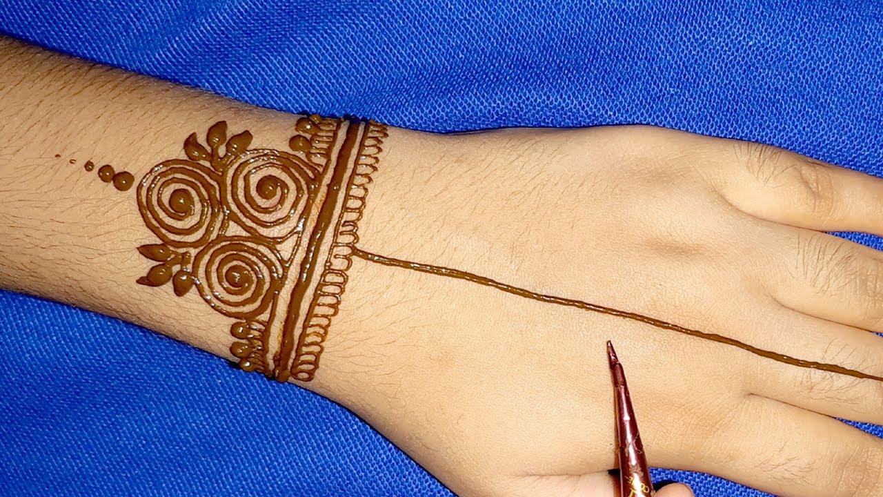 very easy back hand mehndi design-easy Arabic gol tikki mehndi-/festival special mehandi design