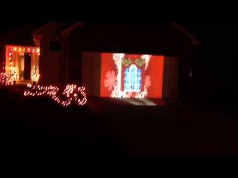 Christmas projector greetings garage door! - Christmas Projector Greetings Garage Door! - YouTube