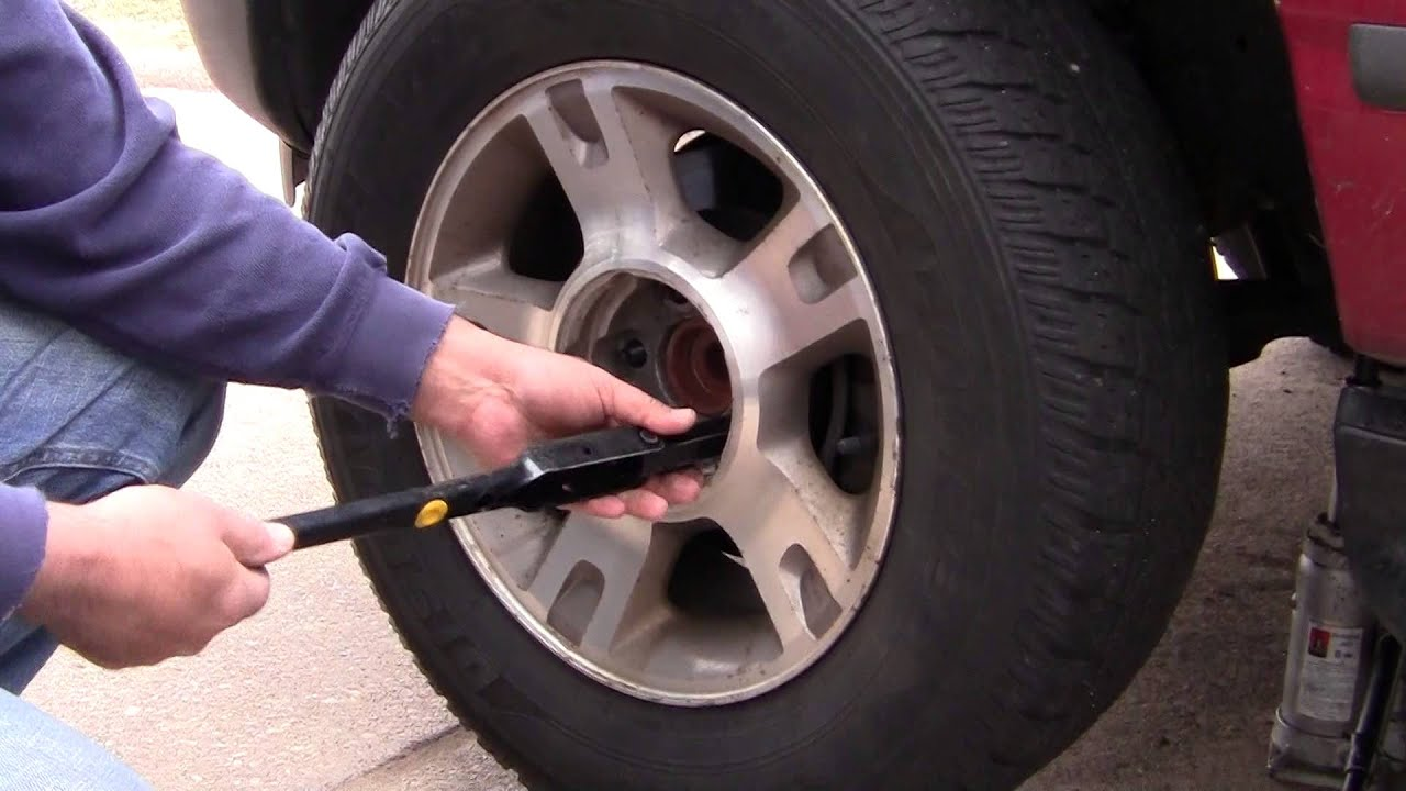 How to Change Tire On 2004 FORD EXPLORER SPARE TIRE - YouTube