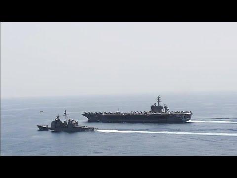 USS Theodore Roosevelt and USS Normandy underway in Arabian Sea