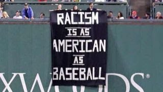BLM inspired protestors display banner during Red Socks game
