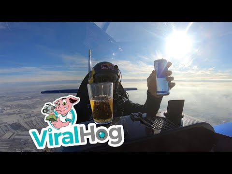 Eric Hunter - Thirsty Pilot Pours A Drink While Doing A Barrel Roll