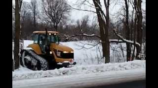 Grooming snowmobile trail with Cat Challenger 1