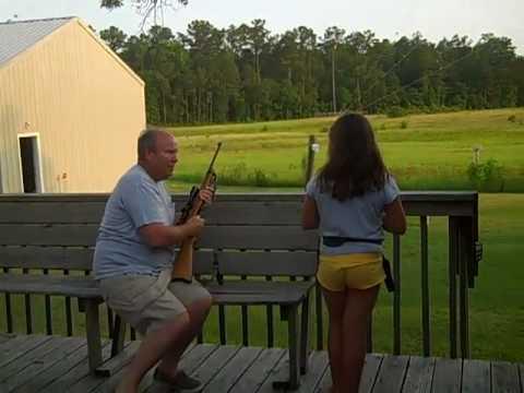 Girl shooting a 22 rifle