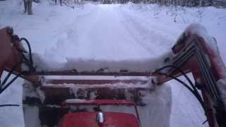 Kubota tractor back blades snow in Maine