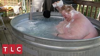 due to his obesity casey must bathe outside in a trough family by the ton